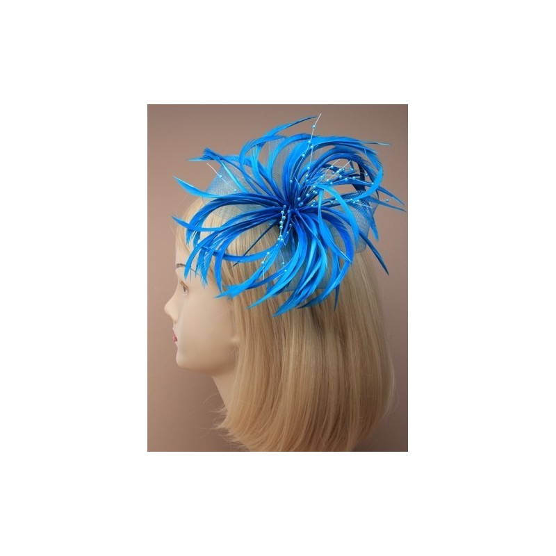 large looped net and feather fascinator on a forked clip and brooch pin. in assortment of blue/turq and gre...