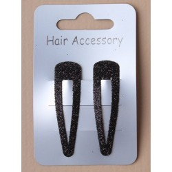 card of 2 black 5cm sleepies. in an assortment of black glitter.