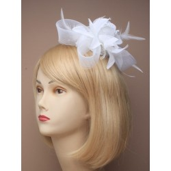 White fascinator with rose on a clear comb.