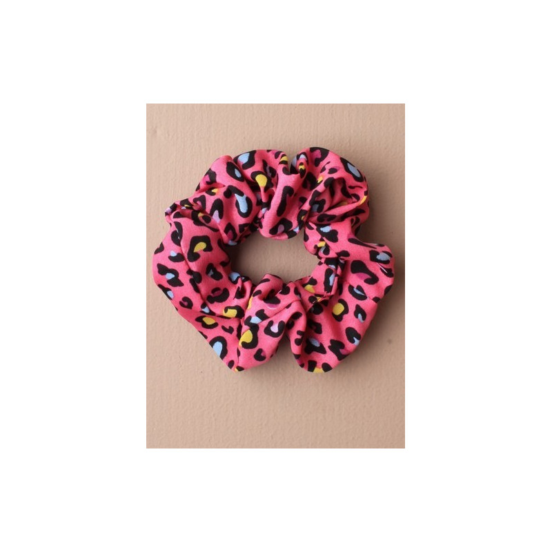 animal color imprimir tela coletero. en un surtido de salmón/rosado y azul.