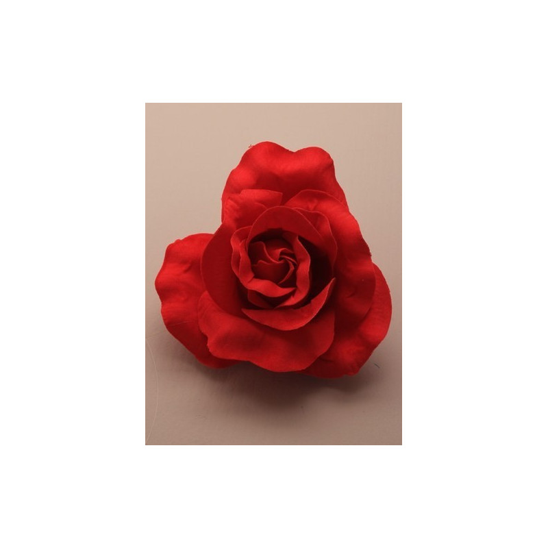 large red fabric rose on a forked clip.