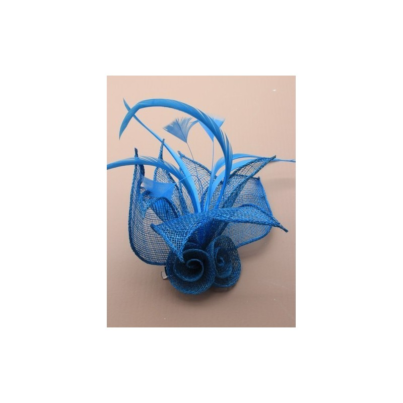 mesh net flower fascinator with feathers on a beak clip and brooch pin. in navy/turq and royal.