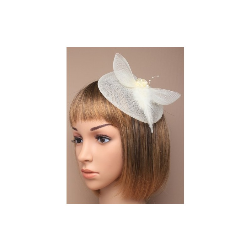 cream net fascinator on a clip and brooch pin.
