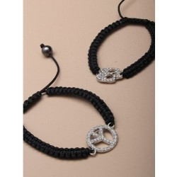 black plaited corded friendship bracelet with diamante peace / skull charm.