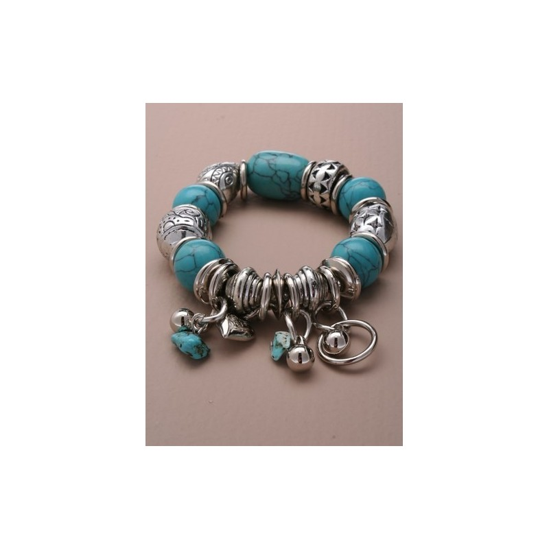 turquoise bead and vintage plated bead and charm stretch braclet. in an assortment of 3 styles.