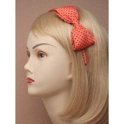 narrow spotty fabric 8mm aliceband with large spotty bow. in an assortment of orange/tan/black and mustard.