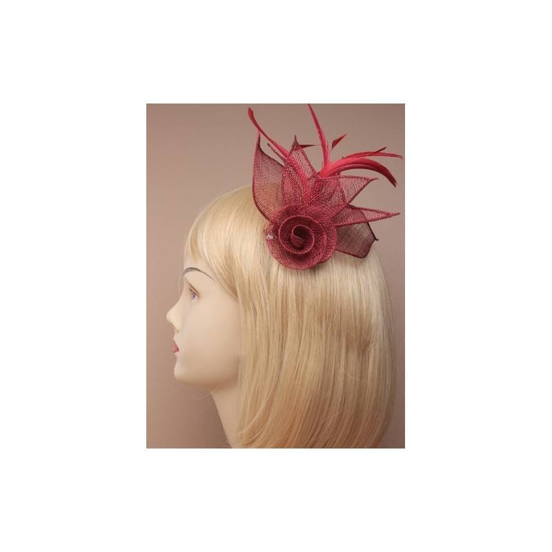 mesh net flower fascinator with feathers on a beak clip and brooch pin. in red/pink and burgundy.