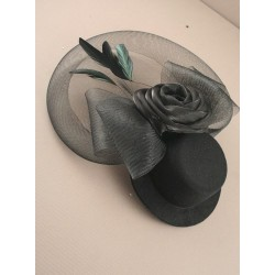 Black hat fascinator with mesh net with fabric rose.