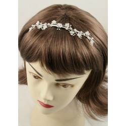 Silv plated crystal tiaras in 3 designs. This item comes...