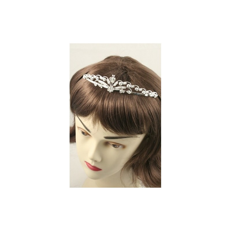 Silv Crystal swirl design tiaras. In 3 assorted styles. Comes packe...