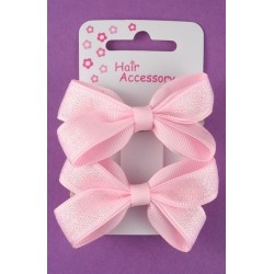 card of 2 small pink bow barrettes.