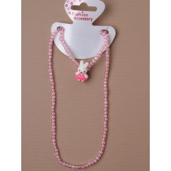 pastel pink stretch bracelet and necklace set with animal motif.