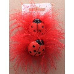 card of 2 coloured ponios with ladybird motif and feathers. in red and pink.