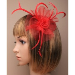 looped net with centre swirl fascinator on a clip and brooch pin. in black/red/navy and cream.