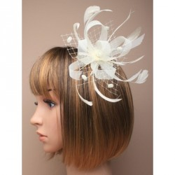 Fascinator Comb - Cream Looped Ribbon and Net with Feathers Fascinator on a clear comb.