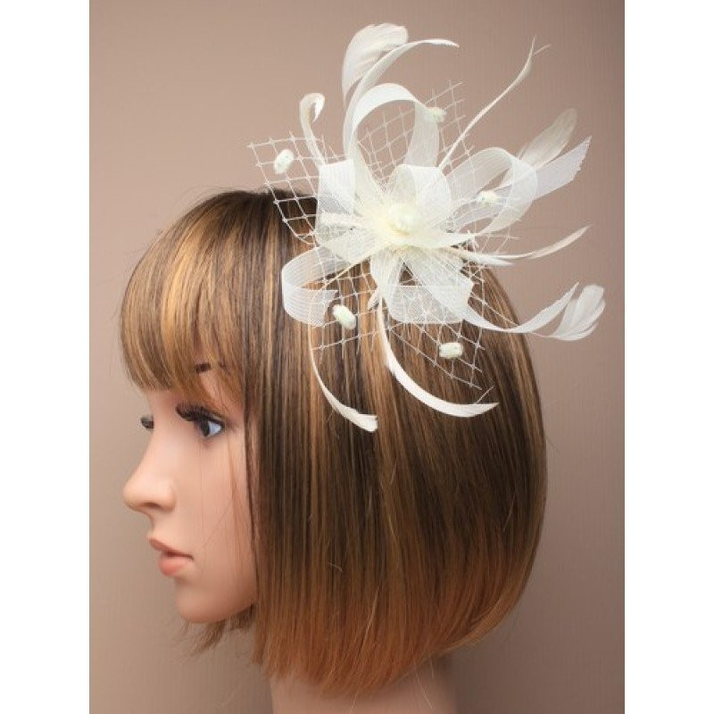 Cream Looped Ribbon and Net with Feathers Fascinator on a clear comb.