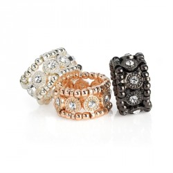 Three pieces rose gold, silver & hematite colour crystal elasticated ring set. - (R31690)