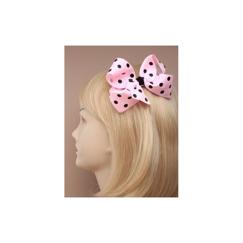 large spotted fabric ribbon bow on a forked clip. in pink/lilac/blue and fuchsia.