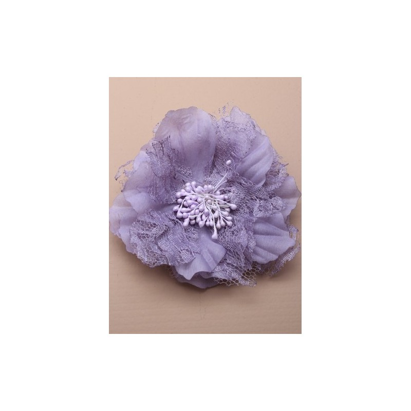 large lace and fabric flower on a silv fork clip