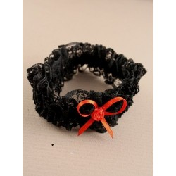 Brides black lace garter with red or black ribbon bow
