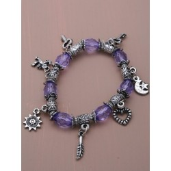 Stretch translucent bead and silv charm bracelet.